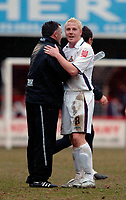 Photo: Daniel Hambury.<br />Brentford v Doncaster Rovers. Coca Cola League 1. 25/03/2006.<br />Doncaster's match winner Sean Thornton celebrates with his manager Dave Penney.