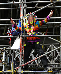 Anti-Brexit campaigners climb scaffolding as they take part in the People's Vote March in London.