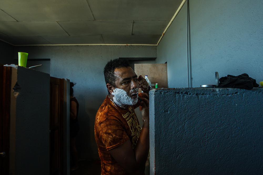 "LA CRUZ, COSTA RICA - JANUARY 5, 2016: Cuban migrant Pedro Enrique Duarte, a 48-year-old accountant, shaves his face inside the bathroom of a local fire station that is functioning as a temporary shelter for Cuban migrants stranded here.   ""I would tell anyone not to take this trip,"" he said. ""You spend the whole time straddling between life and death."" PHOTO: Meridith Kohut for The New York Times"