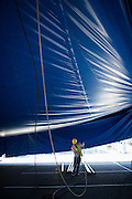 Jefferson Masa gathers a draping rope inside the tent as Circus Vargas pitches the big tent in preparation for a weekend of performances at the Great Mall of the Bay Area in Milpitas, California, on August 27, 2013. (Stan Olszewski/SOSKIphoto)