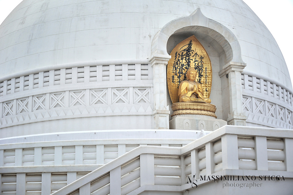 Vishwa Shanti Stupa is a major tourist attraction at Rajgir. Rajgir is a popular pilgrim destination for Buddhists. Nichidatsu Fujii (1885-1985), a Buddhist monk from Japan and founder of the Nipponzan-Myohoji Buddhist sect. Nichidatsu Fujii set an example for world peace through Peace Pagodas. In series of establishing peace pagodas world over he established one such peace pagoda at Rajgir which is called Vishwa Shanti Stupa.<br /> A pagoda is a type of stupa which provides equality for worship and gathering at one place for common cause. The Nipponzan-Myohoji sect has been successful in spreading the views of Lord Buddha for peace and harmony among people. These stupa or Japanese Pagoda are excellent example of oriental style of architecture. Though all of the pagodas are not built under the guidance of Nichidatsu Fujji, most of them have been built either under his guidance or under his recommendations. <br /> World Peace Pagoda at Rajgir is made of spotless white marble and is a remarkable monument. Vishwa Shanti Stupa is the tallest peace Pagoda in the world standing tall at 400 meters and houses four statues of Lord Buddha on the four side-corners of the stupa. <br /> The four statues on four corner-sides of stupa depict the four phases of life of Lord Buddha. These statues are made of gold. These statues depicting, birth, enlightenment, teaching and passing away of Lord Buddha are symbolical of Lord Buddha&rsquo;s teachings and transient life.
