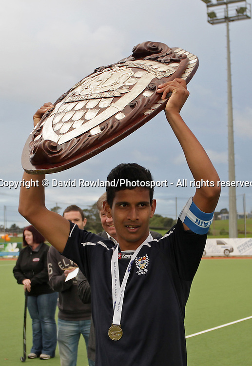 Auckland's captain Arun Panchia with the trophy after defeating Southern in the Ford National Hockey League Final, North Harbour Hockey Stadium, Auckland, New Zealand, Sunday, August 25, 2013. Photo: David Rowland/Photosport
