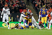 LA Rams Running Back Todd Gurley (30) is tackled during the International Series match between Los Angeles Rams and Cincinnati Bengals at Wembley Stadium, London, England on 27 October 2019.