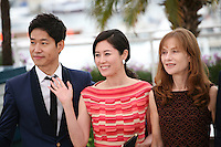 Yu Junsang, Moon Sori,  Isabelle Huppert,  at the DA-REUN NA-RA-E-SUH (IN ANOTHER COUNTRY) film photocall at the 65th Cannes Film Festival. Monday 21st May 2012 in Cannes Film Festival, France.