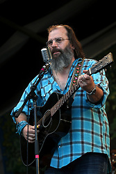 05 May 2012. New Orleans, Louisiana,  USA. .New Orleans Jazz and Heritage Festival. .Steve Earle performs with the 'Preservation Hall and Friends' ensemble. .Photo; Charlie Varley.