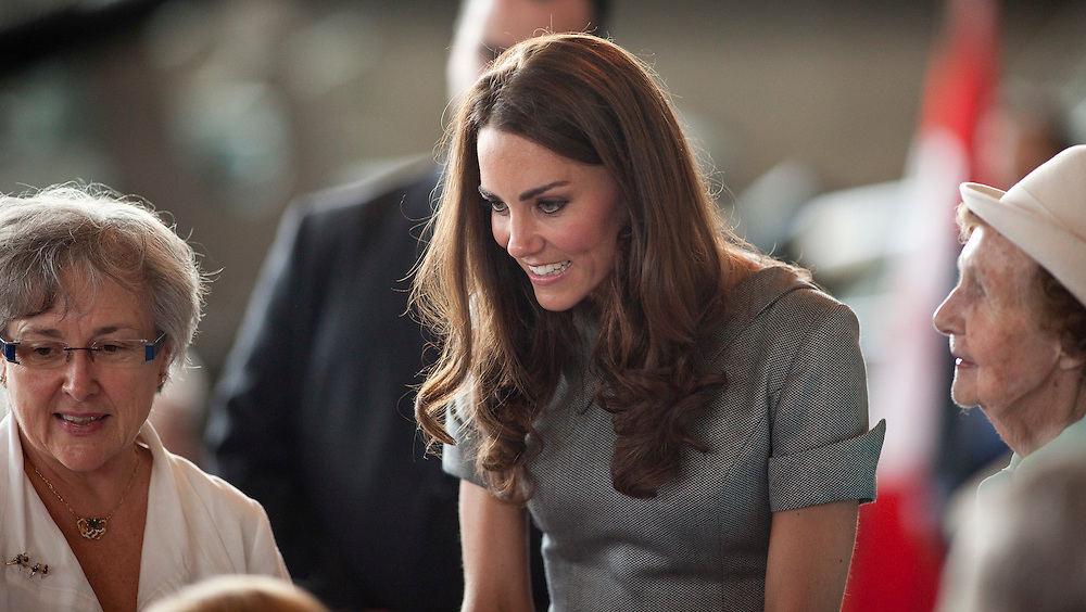 Catherine the Duchess of Cambridge speaks to veterans and their families during a tour the War Museum in Ottawa, Canada, July 2, 2011, on the third day of their nine day tour of Canada.<br /> AFP PHOTO/GEOFF ROBINS