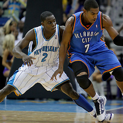 Oct 10, 2009; New Orleans, LA, USA; New Orleans Hornets guard Darren Collison (2) defends against Oklahoma City Thunder guard Kevin Ollie (7) during the second half at the New Orleans Arena. The Hornets defeated the Thunder 88-79.  Mandatory Credit: Derick E. Hingle-US PRESSWIRE