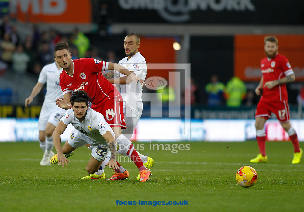 Federico Macheda of Cardiff City and Alex Mowatt of Leeds United during the Sky Bet Championship match at the Cardiff City Stadium, Cardiff<br /> Picture by Mike  Griffiths/Focus Images Ltd +44 7766 223933<br /> 01/11/2014