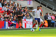 Raheem Sterling of England blocks the ball from Strahil Popov of Bulgaria during the UEFA European 2020 Qualifier match between England and Bulgaria at Wembley Stadium, London, England on 7 September 2019.