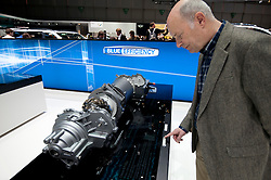 Man looking at Mercedes electric motor for vehicles at he Geneva Motor Show 2011 Switzerland