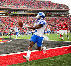 Kentucky running back Stanley Williams runs in a touchdown in the first quarter. The University of Louisville hosted Kentucky, Saturday, Nov. 26, 2016 at Papa John's Cardinal Stadium in Louisville. Kentucky won the game 41-38.