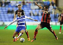 Bournemouth's Yann Kermorgant lunges in for a tackle on Reading's Jordan Obita - Photo mandatory by-line: Alex James/JMP - Mobile: 07966 386802 - 14/04/2015 - SPORT - Football - Reading - Madejski Stadium - Reading v AFC Bournemouth - Sky Bet Championship