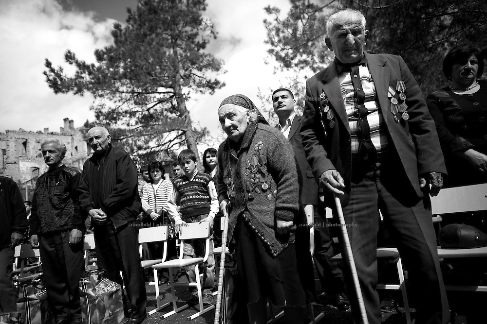 "Two very old World War II veterans during a celebration event. This image is part of the photoproject ""The Twentieth Spring"", a portrait of caucasian town Shushi 20 years after its so called ""Liberation"" by armenian fighters. In its more than two centuries old history Shushi was ruled by different powers like armeniens, persians, russian or aseris. In 1991 a fierce battle for Karabakhs independence from Azerbaijan began. During the breakdown of Sowjet Union armenians didn´t want to stay within the Republic of Azerbaijan anymore. 1992 armenians manage to takeover ""ancient armenian Shushi"" and pushed out remained aseris forces which had operate a rocket base there. Since then Shushi became an ""armenian town"" again. Today, 20 yeras after statement of Karabakhs independence Shushi tries to find it´s opportunities for it´s future. The less populated town is still affected by devastation and ruins by it´s violent history. Life is mostly a daily struggle for the inhabitants to get expenses covered, caused by a lack of jobs and almost no perspective for a sustainable economic development. Shushi depends on donations by diaspora armenians. On the other hand those donations have made it possible to rebuild a cultural centre, recover new asphalt roads and other infrastructure. 20 years after Shushis fall into armenian hands Babies get born and people won´t never be under aseris rule again. The bloody early 1990´s civil war has moved into the trenches of the frontline 20 kilometer away from Shushi where it stuck since 1994. The karabakh conflict is still not solved and could turn to an open war every day. Nonetheless life goes on on the south caucasian rocky tip above mountainious region of Karabakh where Shushi enthrones ever since centuries."