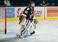 KELOWNA, CANADA, JANUARY 1: Brandon Glover #31 of the Calgary Hitmen warms up in net as the Calgary Hitmen visit the Kelowna Rockets on January 1, 2012 at Prospera Place in Kelowna, British Columbia, Canada (Photo by Marissa Baecker/Getty Images) *** Local Caption ***