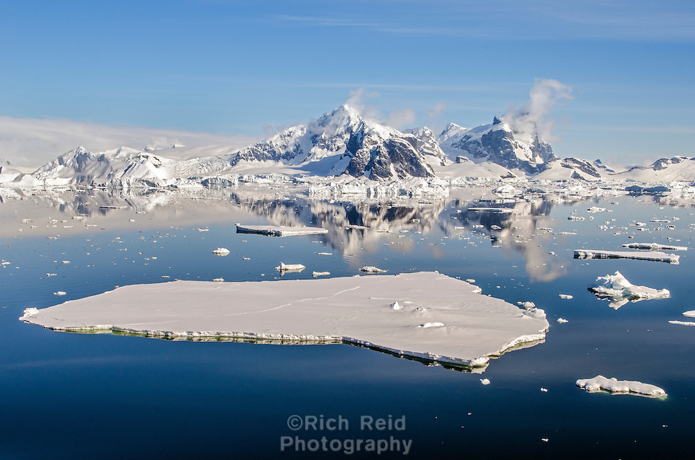 Glacial and sea ice in on the Graham Coast from Grandidier Channel in Antarctica.