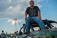 Shane Hebebrand, 17, of Kent, wait for the beginning of the demolition derby aJacob Hinkle, 13, rests on top of his car before the demolition derby at the Summitt County Fairgrounds, Thursday, July 26, 2016 in Tallmadge, Ohio.