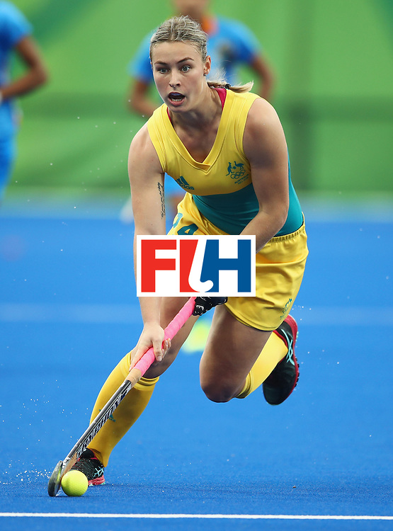RIO DE JANEIRO, BRAZIL - AUGUST 10:  Mariah Williams of Australia dribbles the ball during the Women's Pool B Match between India and Australia on Day 5 of the Rio 2016 Olympic Games at the Olympic Hockey Centre on August 10, 2016 in Rio de Janeiro, Brazil.  (Photo by Mark Kolbe/Getty Images)