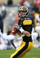 08 NOVEMBER 2008: Iowa quarterback Ricky Stanzi (12) drops back to pass during warmup before an NCAA college football game against Penn State, at Kinnick Stadium in Iowa City, Iowa on Saturday Nov. 8, 2008. Iowa beat Penn State 24-23.