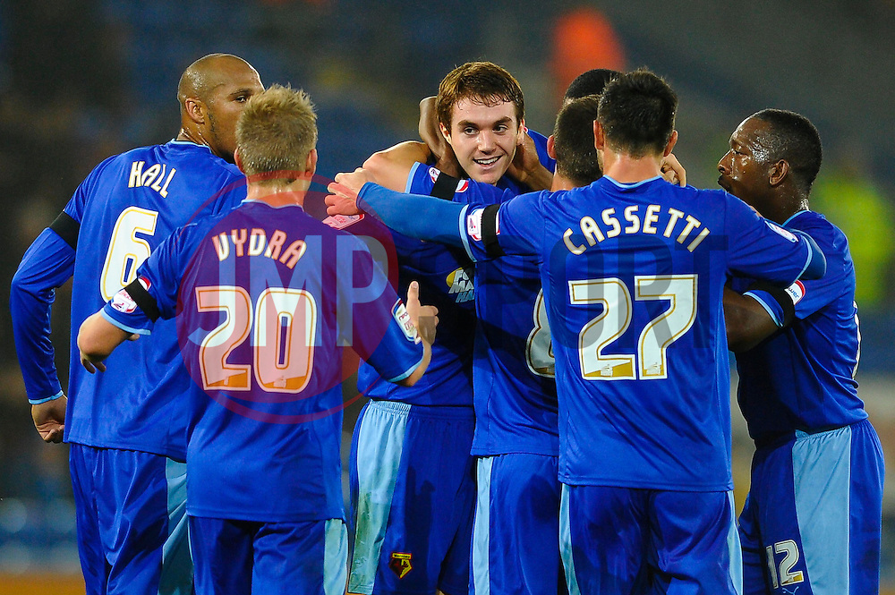 Watford Defender Tommie Hoban (IRL) (centre facing) celebrates with teammates after scoring surprise first goal against the run of play during the first half of the match - Photo mandatory by-line: Rogan Thomson/JMP - Tel: Mobile: 07966 386802 23/10/2012 - SPORT - FOOTBALL - Cardiff City Stadium - Cardiff. Cardiff City v Watford - Football League Championship