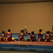 Young gymnasts watch a competitor in action during floor competition at the 21st American Invitational 2014 competition at the XL Centre. Hartford, Connecticut, USA. USA. 31st January 2014. Photo Tim Clayton