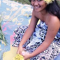 Cook Islands, K?ki '?irani, South Pacific Ocean, Aitutaki, dancer weaving Titi, lei worn around waist