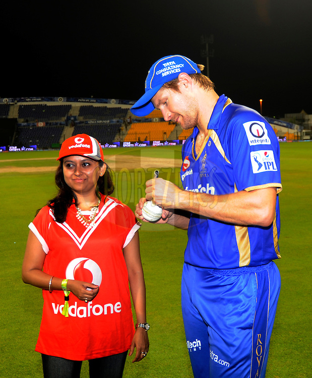 Shane Watson captain of the Rajatshan Royals signs the ball for the Vodafone winner during the presentation after match 19 of the Pepsi Indian Premier League 2014 Season between The Kolkata Knight Riders and the Rajasthan Royals held at the Sheikh Zayed Stadium, Abu Dhabi, United Arab Emirates on the 29th April 2014<br /> <br /> Photo by Pal Pillai / IPL / SPORTZPICS