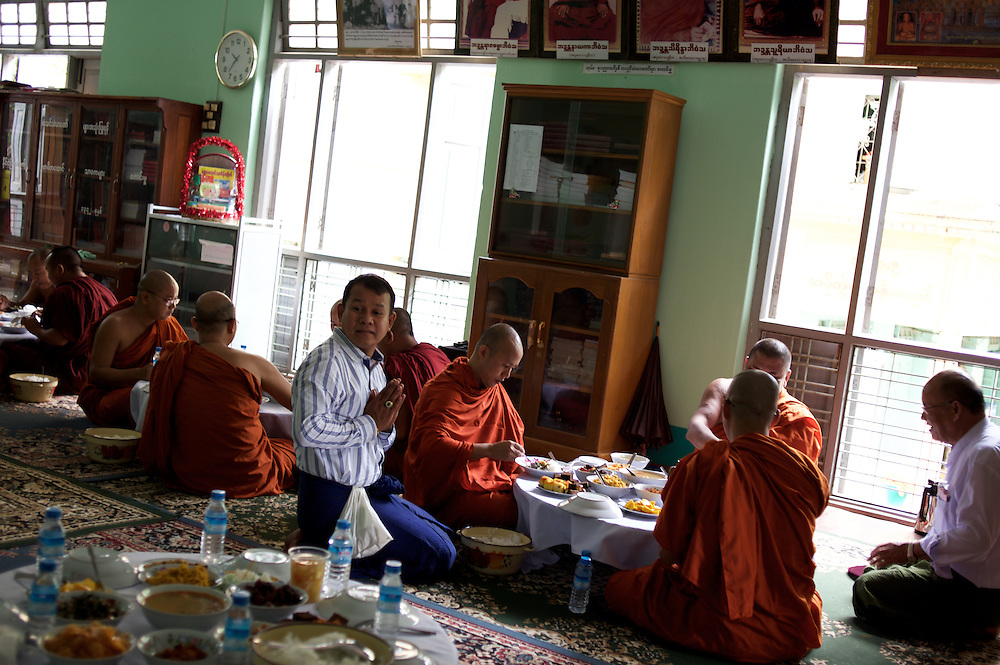 """May 14, 2013 - Mandalay, Myanmar: Ashin Wirathu (centre), the spiritual leader of Burma's Buddhist Nationalist anti-Muslim movement 969 group, takes a midday meal offered by regular citizens at Mosayein Monastery in central Mandalay. Wirathu, who was jailed in 2003 for inciting religious hatred, refers to himself as """"the Burmese Bin Laden"""". CREDIT: Paulo Nunes dos Santos"""