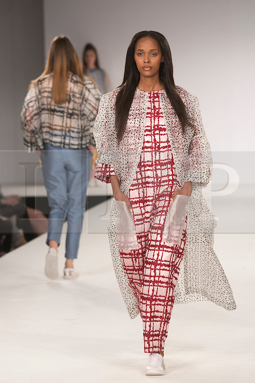 © Licensed to London News Pictures. 31/05/2014. London, England. Collection by Katherine Ogden from UEL, University of East London. Graduate Fashion Week 2014, Runway Show at the Old Truman Brewery in London, United Kingdom. Photo credit: Bettina Strenske/LNP