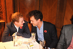 Left to right, GUY PELLY and THOMAS VAN STRAUBENZEE at the Tatler Little Black Book Party held at Tramp, 40 Jermyn Street, London on 3rd November 2010.