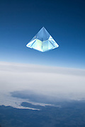 sky pyramid on blue background above clouds layer and earth