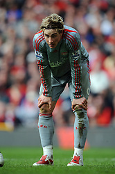 Fernando Torres of Liverpool takes a breather during the Barclays Premier League match between Manchester United and Liverpool at Old Trafford on March 14, 2009 in Manchester, England.