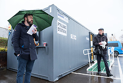 © Licensed to London News Pictures. 12/12/2019. Bristol, UK. General Election 2019; People go to the polls in the rain on election day in Bristol North West at a Portacabin on Tesco Car Park, Tesco Superstore, Lime Trees Road. Photo credit: Simon Chapman/LNP.