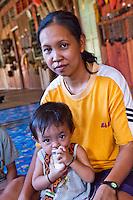 A mother with her baby at Nanga Sumpa Longhouse, Sarawak.