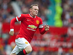 16.08.2014, Old Trafford, Manchester, ENG, Premier League, Manchester United vs Swansea City, 1. Runde, im Bild Manchester United's Wayne Rooney in action against Swansea City // 15054000 during the English Premier League 1st round match between Manchester United and Swansea City AFC at Old Trafford in Manchester, Great Britain on 2014/08/16. EXPA Pictures &copy; 2014, PhotoCredit: EXPA/ Propagandaphoto/ David Rawcliffe<br /> <br /> *****ATTENTION - OUT of ENG, GBR*****