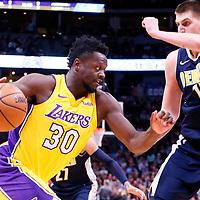 09 March 2018: Los Angeles Lakers forward Julius Randle (30) drives past Denver Nuggets center Nikola Jokic (15) during the Denver Nuggets125-116 victory over the Los Angeles Lakers, at the Pepsi Center, Denver, Colorado, USA.