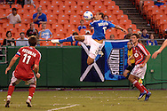 July 1, 2007 - Kansas City, MO..Kansas City Wizards forward Yura Movsisyan #17 goes up high to put a shot on goal in the second half against pressure formToronto FC defenders Jim Brennan #11 and Todd Dunivant #22 at Arrowhead Stadium in Kansas City, Missouri on July 1, 2007...MLS:  The Toronto FC and Wizards ended in a 1-1 tie.   .Photo by Peter G. Aiken / Cal Sport Media
