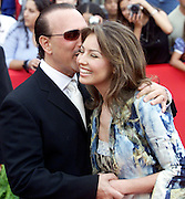 Tommy Matula whispers something in the ear of latin recording artist Thalia as they arrive at the Latin Billboard Music Awards in Miami Beach, Florida April 26, 2001. Photo by:Eric Hampton