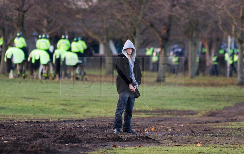 © under license to London News Pictures. 11/12/2010. Continuing their protests in towns and cities across the UK, the English Defence League protest against militant Islam in Peterborough. This EDL supporter urinates in the middle of the Embankment.