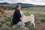 John Daniel Shannon, 48, a former US Army Senior Sniper, is playing with Miko, his loyal Akita dog, near his home in Westcliffe, CO, USA, where he retired with his family after a serious brain injury inflicted by an insurgent sniper in Ramadi, Al Anbar Province, Iraq, on November 13th 2004. Daniel fought during the Second Battle of Fallujah and was then moved to nearby Ramadi. Daniel lost his left eye and has multiple health issues because of his injury: memory problems, balance problems, he can't smell and taste well anymore, he suffers from PTSD, has  troubles with large crowds and city surroundings. This is the reason why he and his family moved to a quiet location on the Rocky Mountains. In 2007 Dan helped the Washington Post to uncover patients' neglect at the Walter Reed Army Medical Center; he also testified before Congress. Torrey, 42, his wife, is a freelance writer and a contributor for the Huffington Post; she's also campaigning to improve the situation of veterans' families.