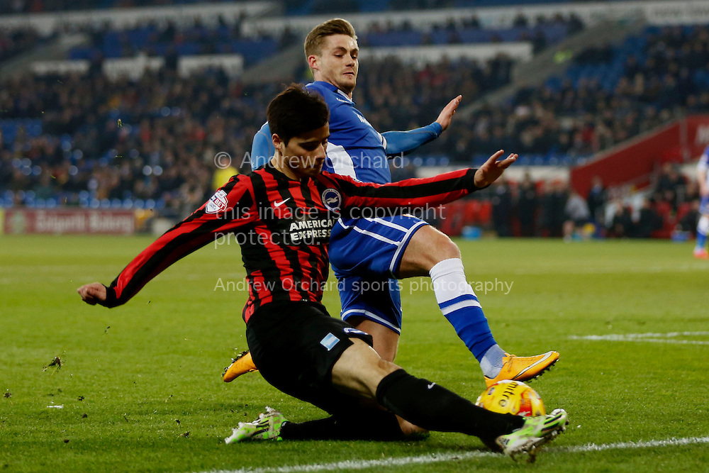 Joao Teixeira of Brighton attempts to cross under a challenge from Stuart O'Keefe of Cardiff City.<br /> Skybet football league championship match, Cardiff City v Brighton &amp; Hove Albion at the Cardiff city Stadium in Cardiff, South Wales on Tuesday 10th Feb 2015.<br /> pic by Mark Hawkins, Andrew Orchard sports photography.
