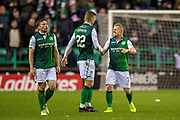 Florian Kamberi (#22) of Hibernian FC is congratulated by Daryl Horgan (#7) of Hibernian FC after scoring the equalising goal during the Ladbrokes Scottish Premiership match between Hibernian and Rangers at Easter Road, Edinburgh, Scotland on 8 March 2019.