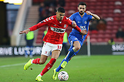 Middlesbrough forward Ashley Fletcher (18) and Peterborough United defender Danny Lafferty (18) battle for the ball during The FA Cup 3rd round match between Middlesbrough and Peterborough United at the Riverside Stadium, Middlesbrough, England on 5 January 2019.