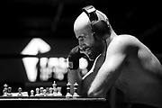 Amateur Chessboxer Mohamad Khadijah is contemplating his next move in a round of chess during a chessboxing match at the Intellectual Fight Club in Berlin, Germany on the 15th of December 2017. <br />
