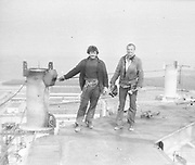 """AMAZING Photo Film discovered Documenting Work In Chernobyl <br />Chernobyl worker Aleksandr Shubovskiy captures rare images <br /><br />During one of the days in 1979-80, when the erection of Ventilation Stack VT-2 common for the third and fourth (not existed at that time) Chernobyl NPP Units was coming to the end, Aleksandr Shubovskiy, who was working within a combined installation crew in a company named """"Spetsenergomontazh"""", arranged with the colleagues a small photo session on his own,They had their pictures taken.<br /><br />The author processed the film and put it on a wardrobe without printing until he had time to print the images. The moment to print the film somehow did not happen, while in February 1986 Aleksandr hit the road for a on a different site in Yakutia. And there he was caught by news about the accident at Chernobyl.<br /><br />A year later, when a Aleksandr  managed to get into his looted flat in the evacuated Pripyat, he discovered an untouched package with films. He brought them home and… forgot for almost 40 years…the printed photographs which no one and never have seen before until now<br /><br />Photo shows: Builders. It looks like a crane hook blocks a view to a juvenile Pripyat.<br />©Aleksandr Shubovskiy/Exclusivepix Media"""