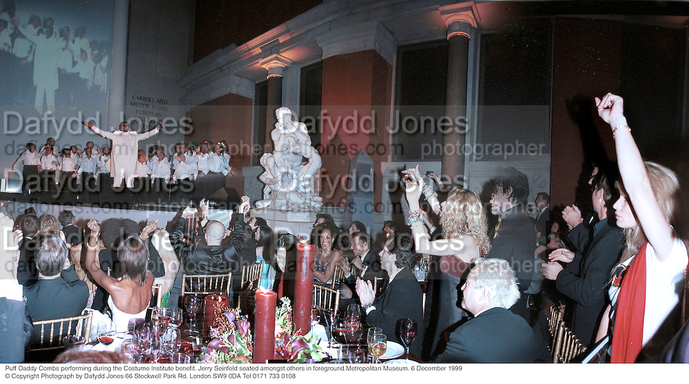 Puff Daddy ( Sean Combs ) performing during the costume Institute benefit. Jerry Seinfeld seated amongst others in foreground. Metropolitan Museum. New York. 6 December 1999.<br /> © Copyright Photograph by Dafydd Jones 66 Stockwell Park Rd. London SW9 0DA Tel 0171 733 0108