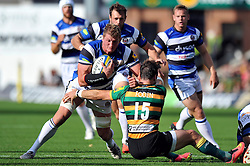 Bath Rugby captain Stuart Hooper takes on Ben Foden of Northampton Saints - Photo mandatory by-line: Patrick Khachfe/JMP - Mobile: 07966 386802 27/09/2014 - SPORT - RUGBY UNION - Northampton - Franklin's Gardens - Northampton Saints v Bath Rugby - Aviva Premiership