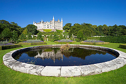 Dunrobin Castle with pond and gardens at Golspie, Highland, Scotland. Castle is seat of the Earl of Sutherland and the Clan Sutherland; United Kingdom