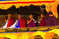 Monks playing horns,  Paro Tsechu (festival), Paro, Bhutan