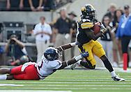 September 19, 2009: Iowa wide receiver Paul Chaney Jr. (26) tries to get around Arizona cornerback Robert Golden (1) during the Iowa Hawkeyes' 27-17 win over the Arizona Wildcats at Kinnick Stadium in Iowa City, Iowa on September 19, 2009.