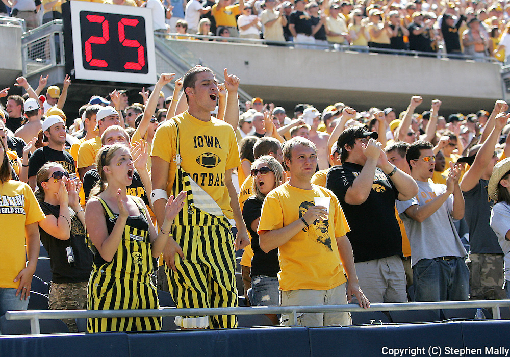 01 SEPTEMBER 2007: Iowa fans cheer on their team during Iowa's 16-3 win over Northern Illinois at Soldiers Field in Chicago, Illinois on September 1, 2007.